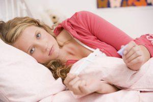 Боли внизу живота при ранней беременности могут быть вызваны перестройкой организма