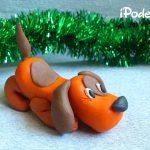 Оранжевая собачка к Новому году из пластилина